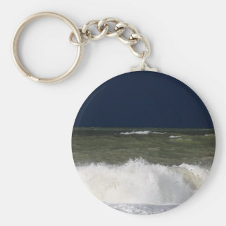 Stormy sea with waves und a dark blue sky. keychain