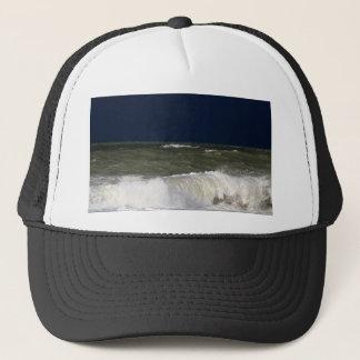 Stormy sea with waves und a dark blue sky. trucker hat