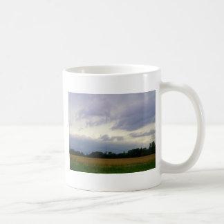 Stormy skies bad weather approaching farm fields coffee mug