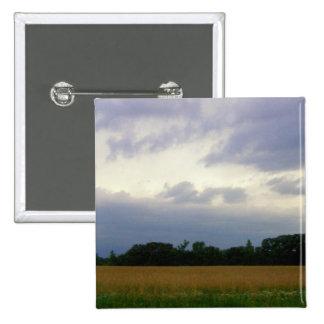 Stormy skies bad weather approaching farm fields pinback button