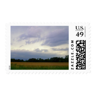 Stormy skies bad weather approaching farm fields postage