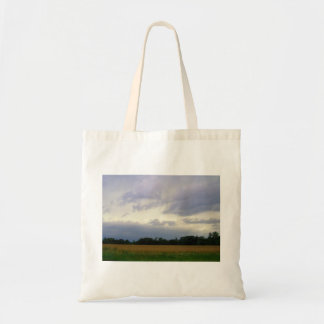 Stormy skies bad weather approaching farm fields tote bag