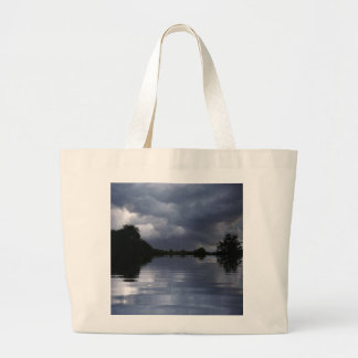 stormy sky and water tote bag