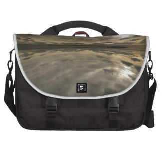Stormy sky reflected in water bag for laptop