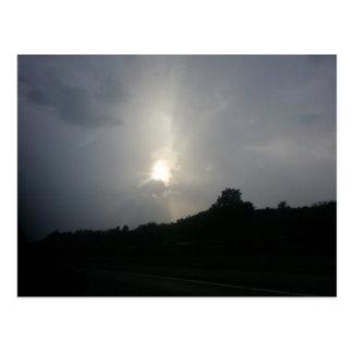 Stormy sunlight postcard