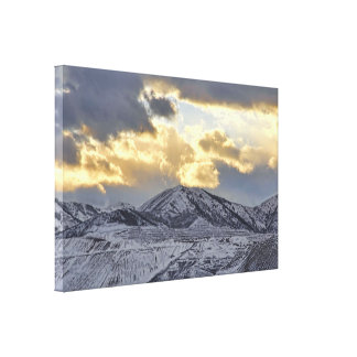 Stormy Sunset Over Snow Capped Mountains Canvas Print