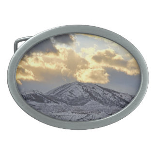Stormy Sunset Over Snow Capped Mountains Oval Belt Buckle