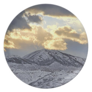 Stormy Sunset Over Snow Capped Mountains Plate