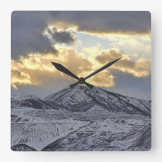 Stormy Sunset Over Snow Capped Mountains Square Wall Clock
