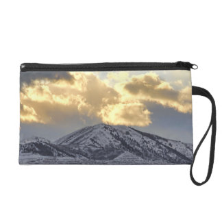 Stormy Sunset Over Snow Capped Mountains Wristlet