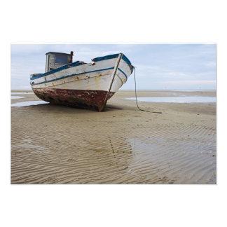 Stranded fishing boat photo
