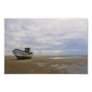 Stranded fishing boat photographic print