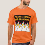 """STRANGE THINGS ARE HAPPENING Sandra Boynton T-Shirt<br><div class=""""desc"""">Here you have the legendary Nervous Chickens from Sandra Boynton's EEK! HALLOWEEN! Unsurprisingly,  they are terrified to suddenly find themselves on a T-Shirt. The STRANGE THINGS ARE HAPPENING message is perfect for Halloween. Or,  honestly,  pretty much year-round nowadays.</div>"""