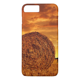 Straw bales on farmland with red cloudy sky iPhone 7 plus case