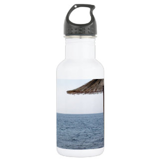 Straw Umbrellas on the Beach 18oz Water Bottle