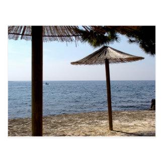 Straw Umbrellas on the Beach Postcard