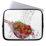Strawberries in a red colander laptop sleeve