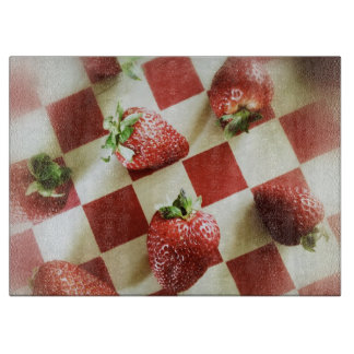 Strawberries on checkerboard cutting boards