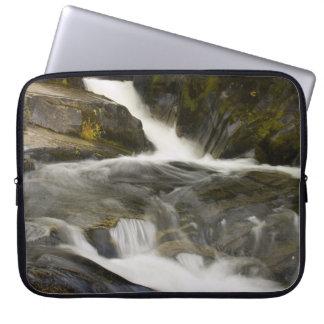Stream flowing over rocks computer sleeve