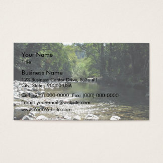 Stream flowing through trees business card