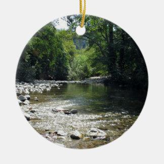 Stream flowing through trees ceramic ornament