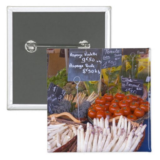 Street market merchant's stall with white 2 inch square button