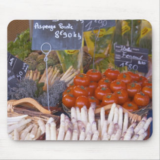 Street market merchant's stall with white mouse pad