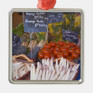 Street market merchant's stall with white square metal christmas ornament