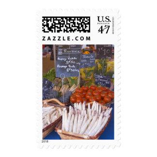 Street market merchant's stall with white postage