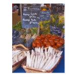 Street market merchant's stall with white postcard