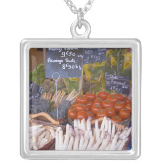 Street market merchant's stall with white square pendant necklace