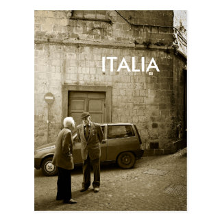Street scene in sepia postcard with text: 'Italia'