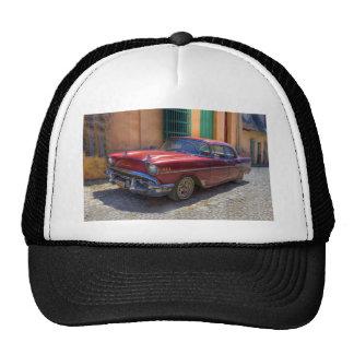 Street scene with old car in Havana Trucker Hat