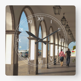 Street with arches square wall clock
