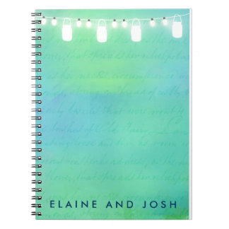 String lights and mason jars in blue green spiral note books