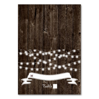 String of lights  on old wood wedding escort card