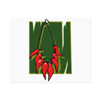 string of red peppers green back canvas print