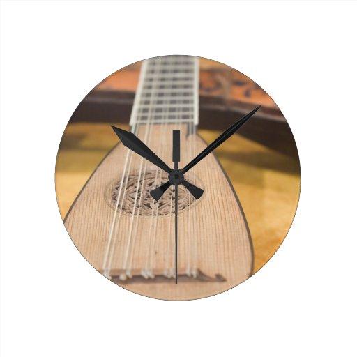 stringed instrument III Round Wall Clocks