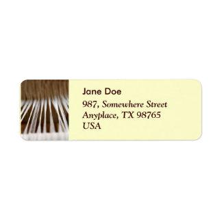 Strings in a loom label