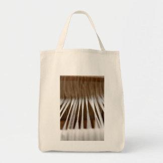 Strings in a loom tote bag