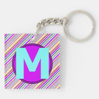Strip pattern all over and monogram M Keychain