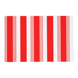 Striped and solid reversible placemat shown in red