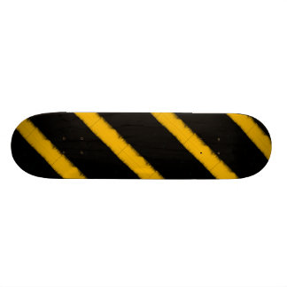 Striped yellow and black skateboard deck