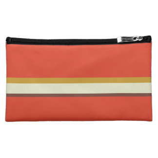 Stripes in ochre green brown on red makeup bag