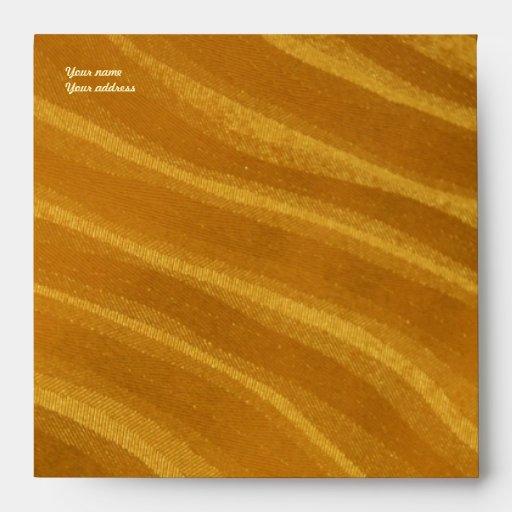 stripes of gold envelopes