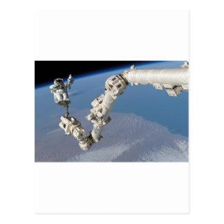 STS-114_Steve_Robinson_on_Canadarm2.jpg Postcard