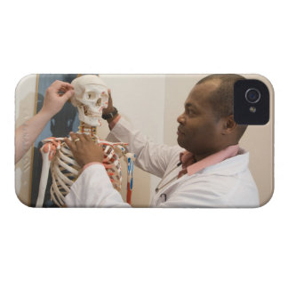 Student doctors studying anatomy on a skeleton iPhone 4 case