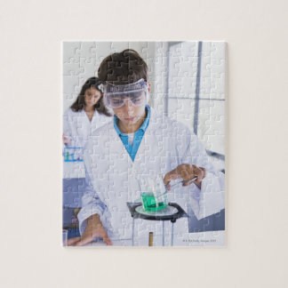 Student doing science experiment 2 puzzles