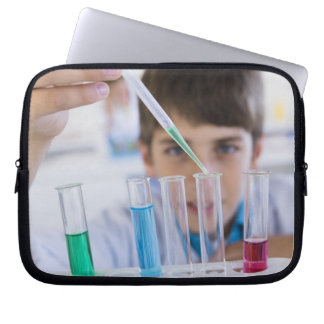 Student doing science experiment 3 computer sleeve