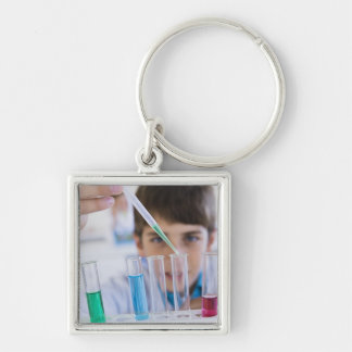 Student doing science experiment 3 keychain